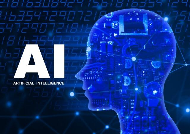 AIイメージ画像(白文字で大書された「AI」に向き合う人工知能を備えた人間の頭部)