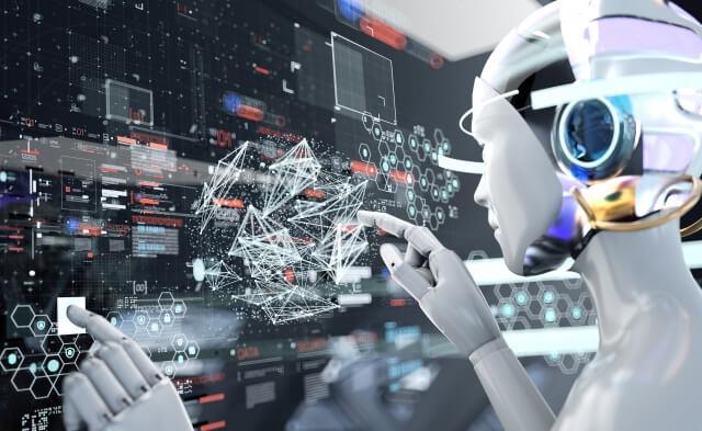 高度電子コンピューターを操作する人間型ロボット